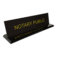 """This stock notary desk sign is 2"""" x 8"""" with the text Notary Public. Available in 5 sign and 2 base colors. Orders over $25 ship free!"""